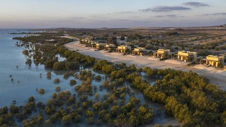 Anantara_Sir_Bani_Yas_Island_Al_Yamm_Villa_Resort_Exterior_View_Mangrove_Villas_with_Lagoon_and_Island_Aerial