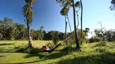 Elephant-Pepper-Camp---Honeymoon-Tent---Relaxing-in-hammock
