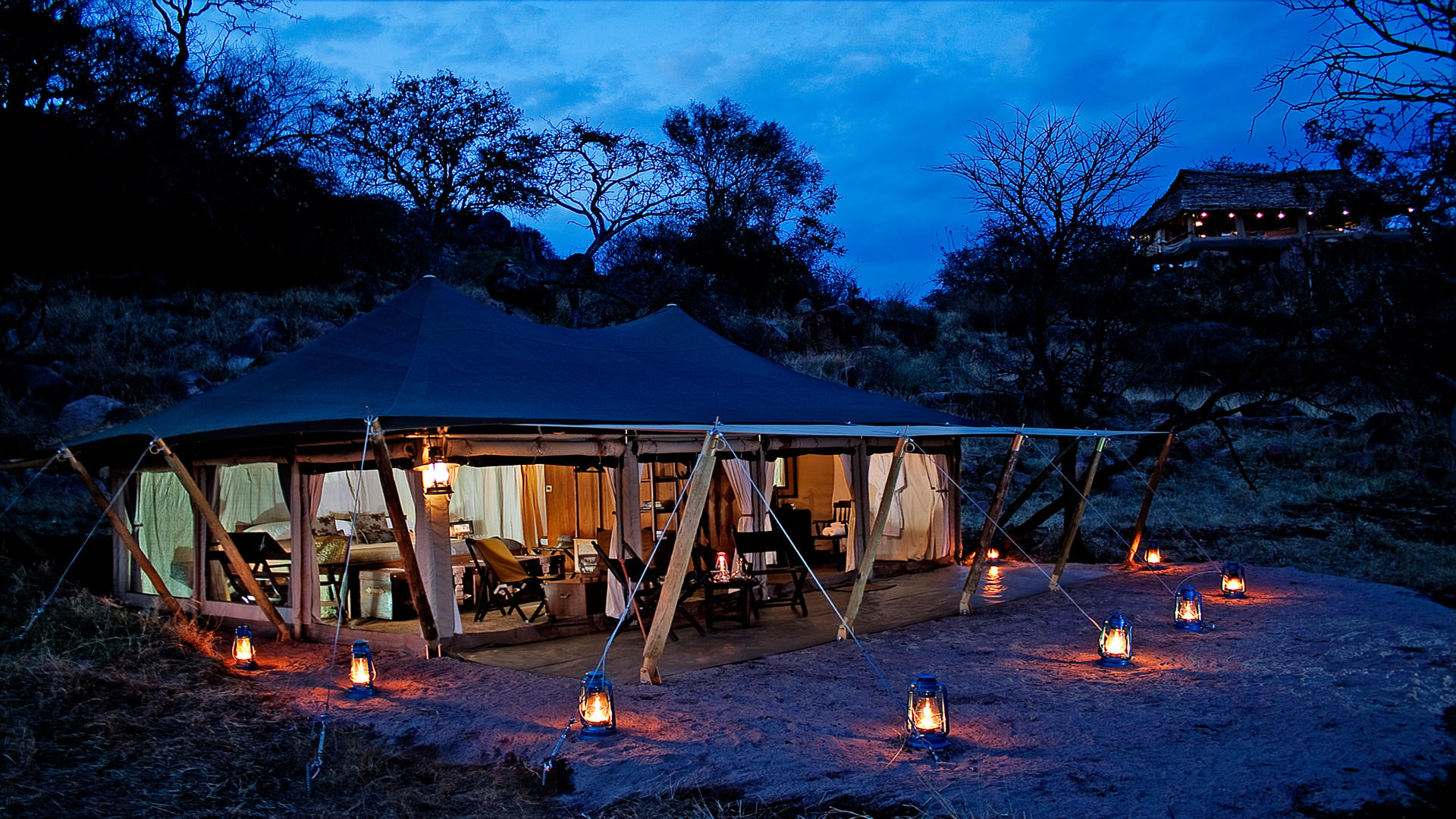 Serengeti-Pioneer-Camp---Tent-Exterior-at-Night-1