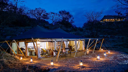 Serengeti-Pioneer-Camp---Tent-Exterior-at-Night-2