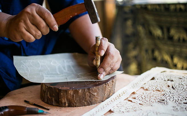 Art of traditional leather carving outrigger koh samui