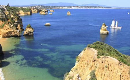 Tivoli-Lagos_Ponta-da-Piedade-Grotto-with-a-local-fisherman